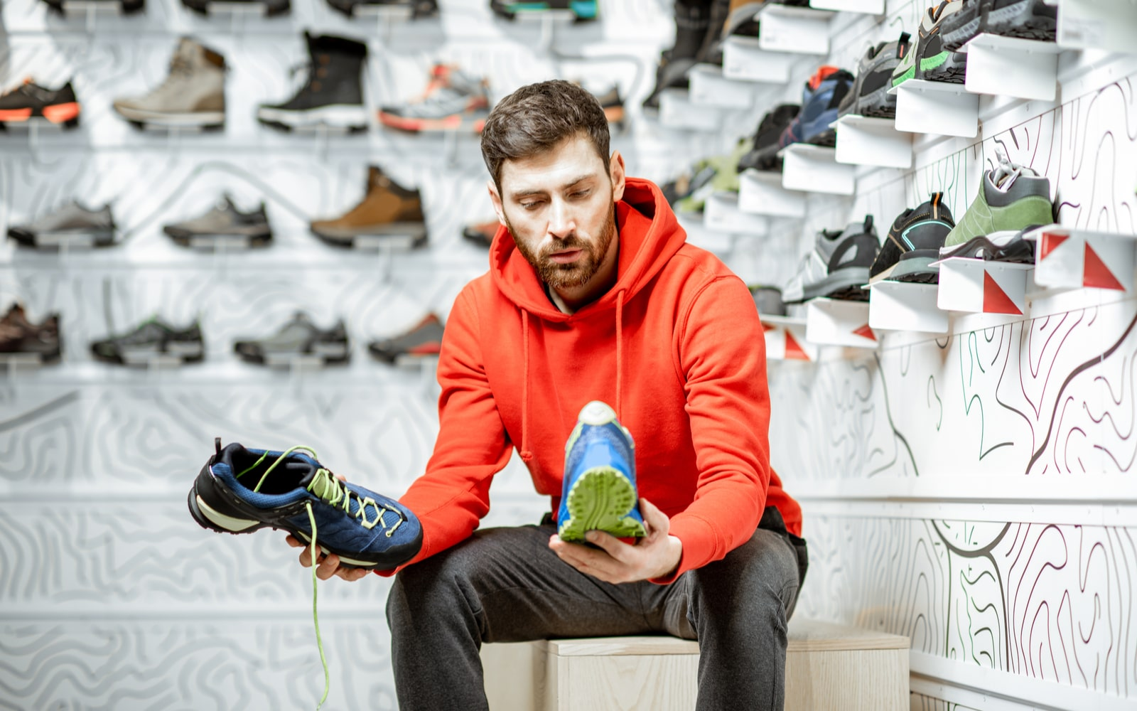 Man trying to select a shoe