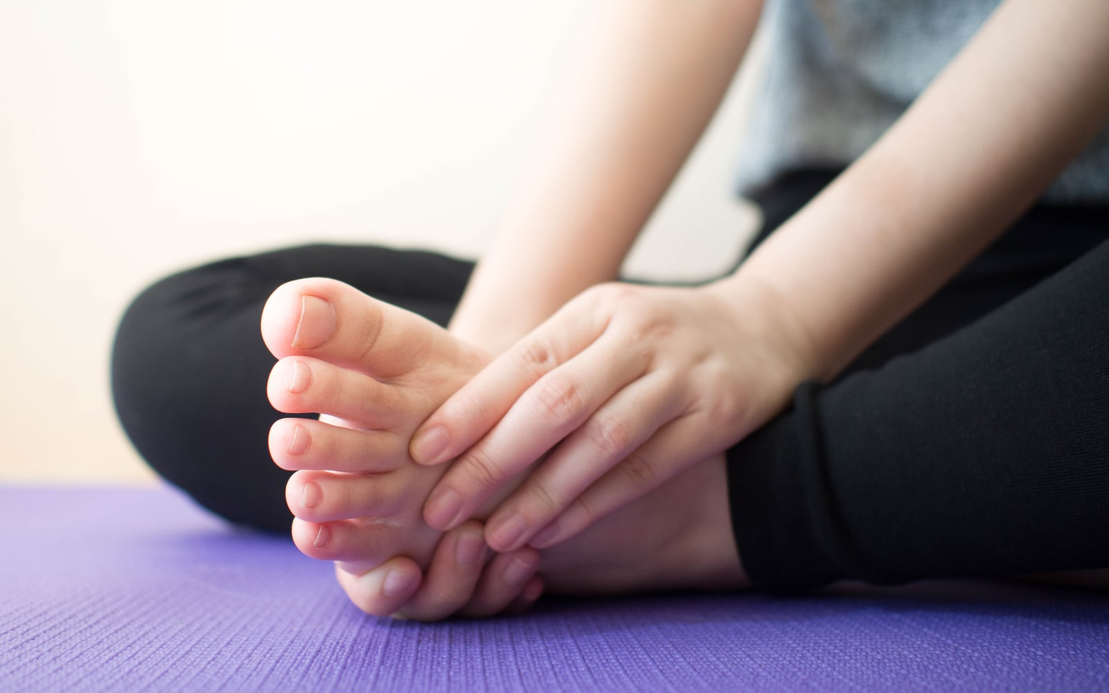Athlete holding their foot in pain